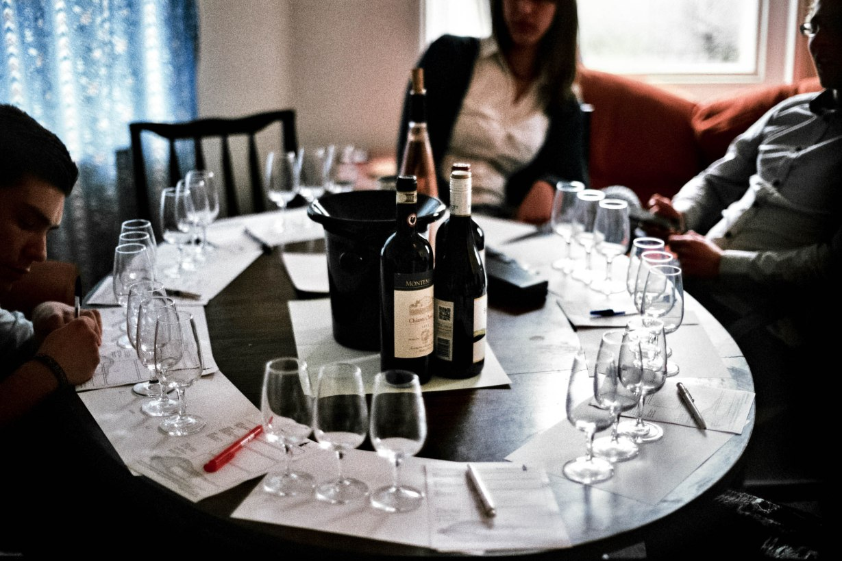 The table was neatly laid out with three glasses per place. The group sat talking and introducing themselves.